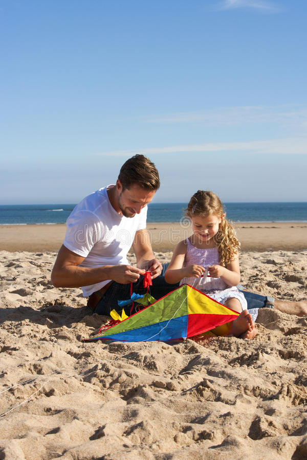 Father and Daughter with Kite stock photography