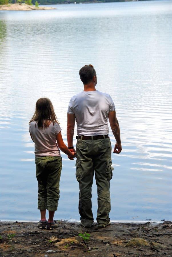 Father daughter lake stock photos