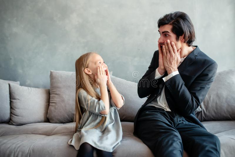 Father and daughter look together shocked something stock photo
