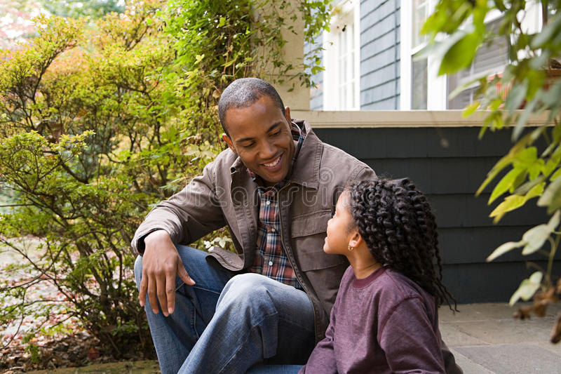 Father and daughter outside house royalty free stock photos