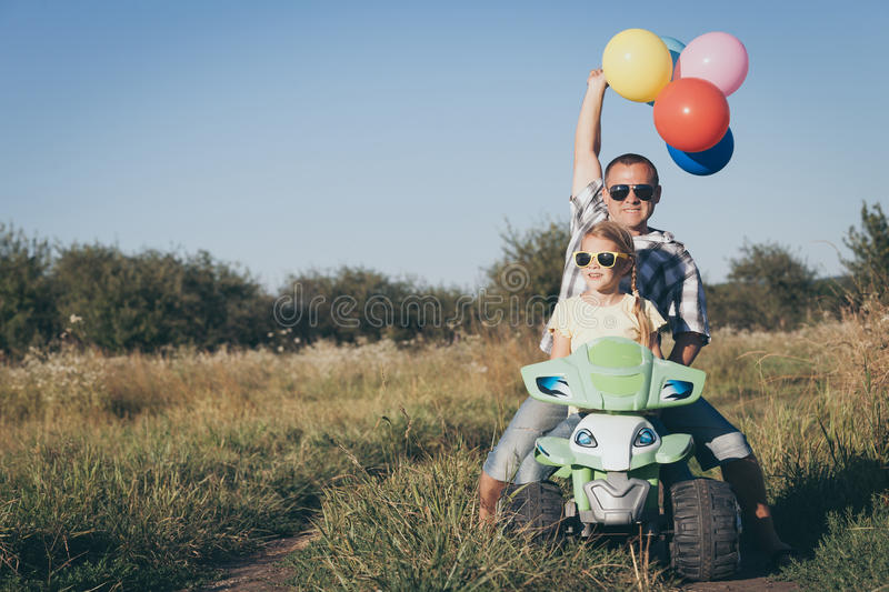 Father and daughter playing on the road at the day time. royalty free stock photo