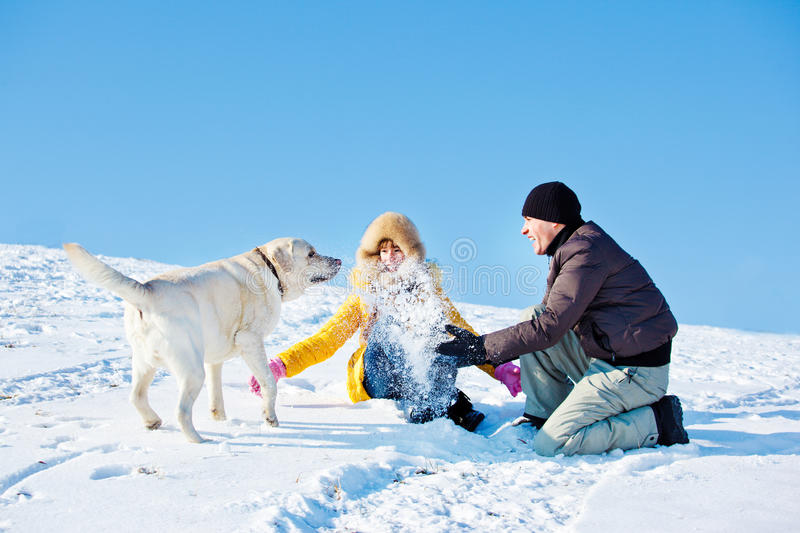 Father and daughter playing with snow royalty free stock images