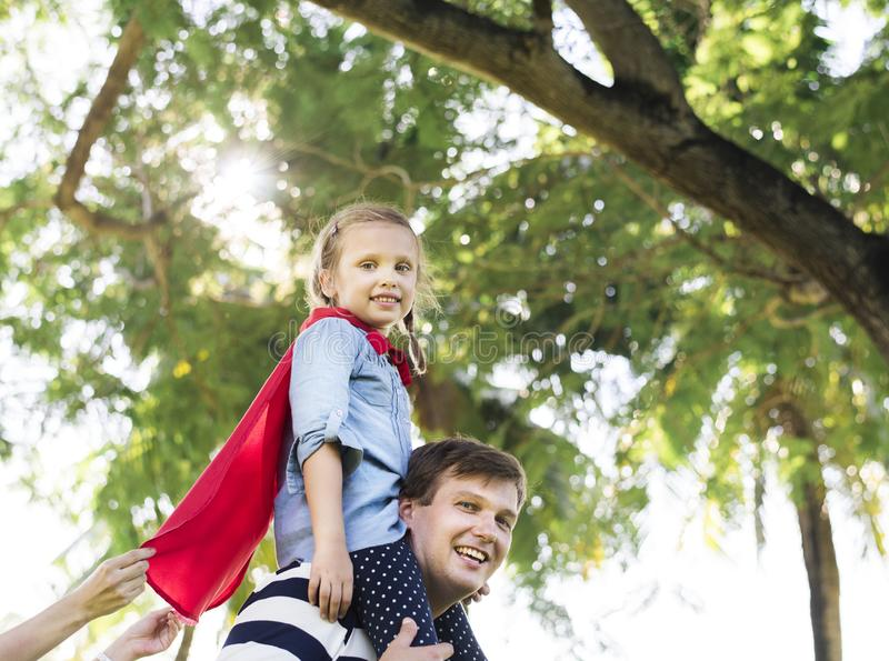 Father and daughter playing superheroes stock image