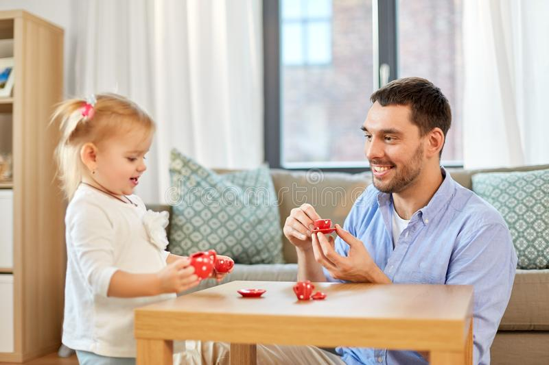 Father and daughter playing tea party at home royalty free stock photo