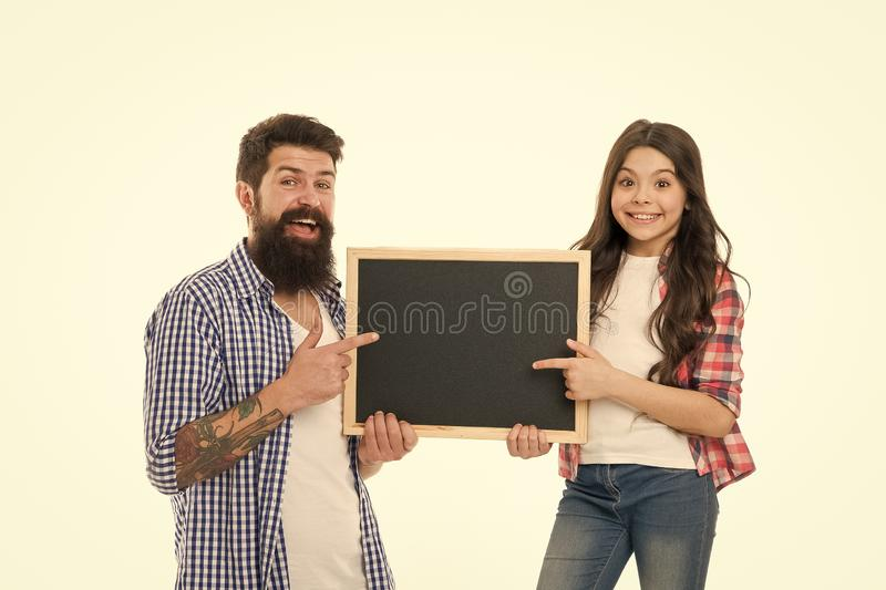 Father and daughter pointing at blank chalkboard. List things to do together. Child and father best friends. Parenthood royalty free stock image