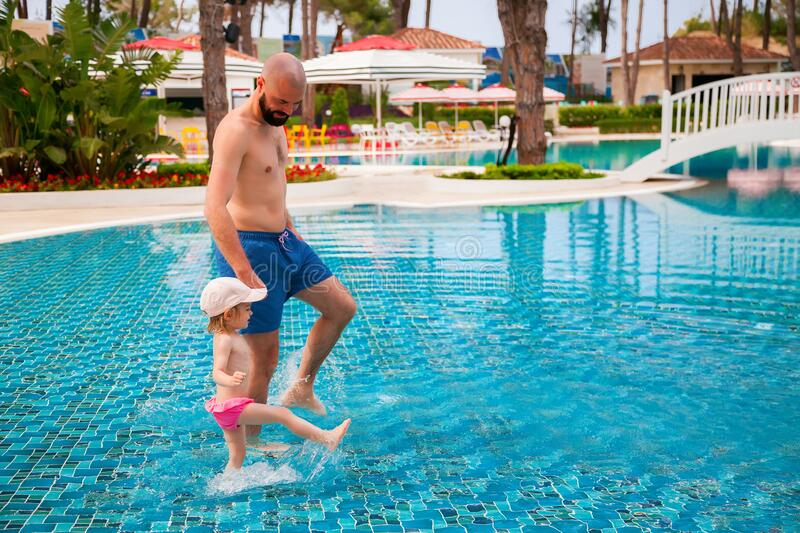 Father and daughter in the pool royalty free stock images