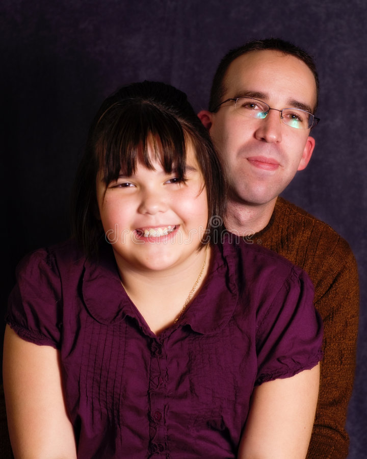 Father Daughter Portrait. A young father and his daughter, getting their portrait done together stock photo