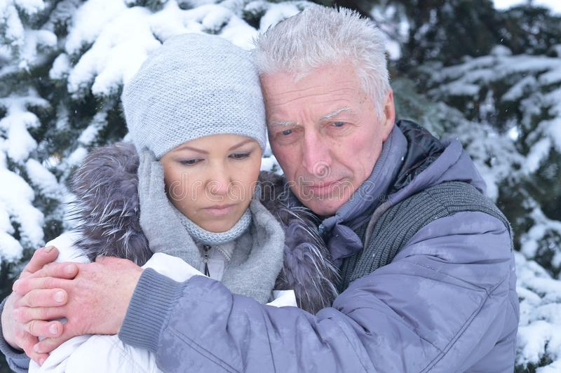 Father with daughter posing outdoors. In winter stock photo