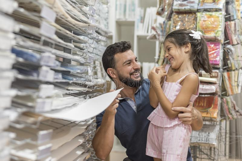Father and daughter preparing homework and back to school. Smiling royalty free stock images