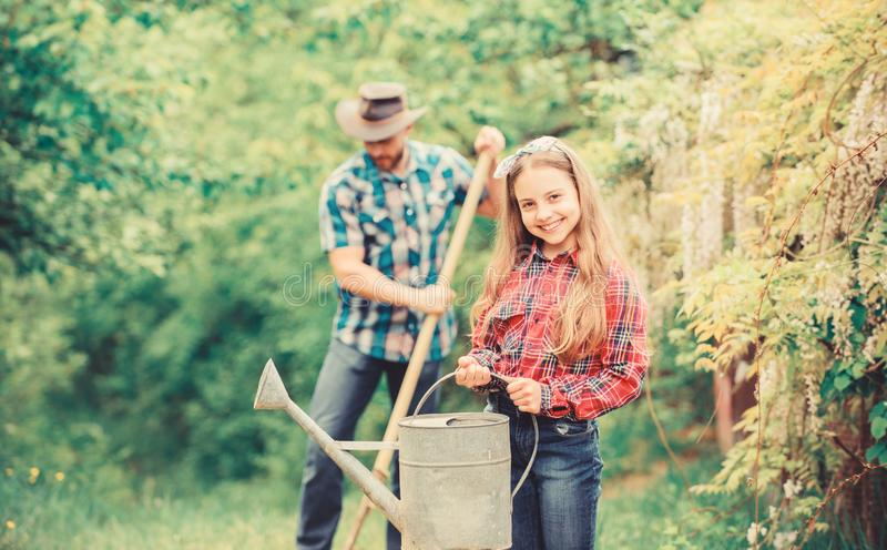 Father and daughter on ranch. family farm. little girl and happy man dad. earth day. spring village country. ecology. Father and daughter on ranch. family farm stock images