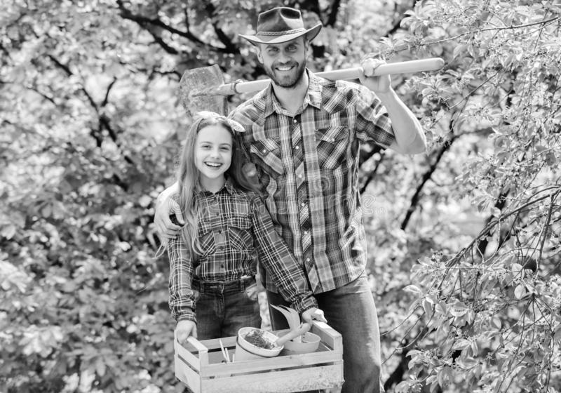 Father and daughter on ranch. little girl and happy man dad. earth day. new life. spring village country. ecology stock image