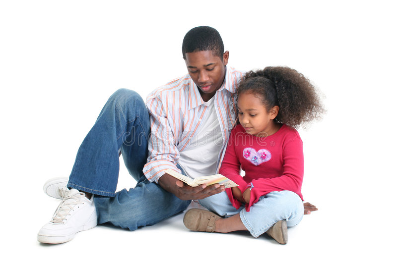 Father Daughter Reading. Attractive African American man and child reading together royalty free stock image