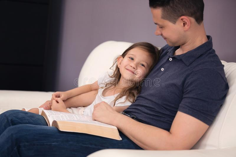 Father and Daughter Reading the Bible stock photos