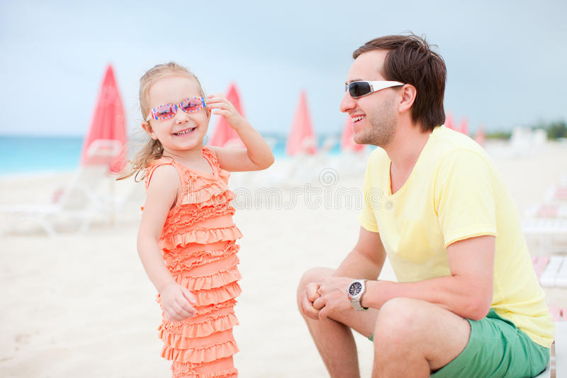 Father And Daughter At Resort Beach Stock Photo