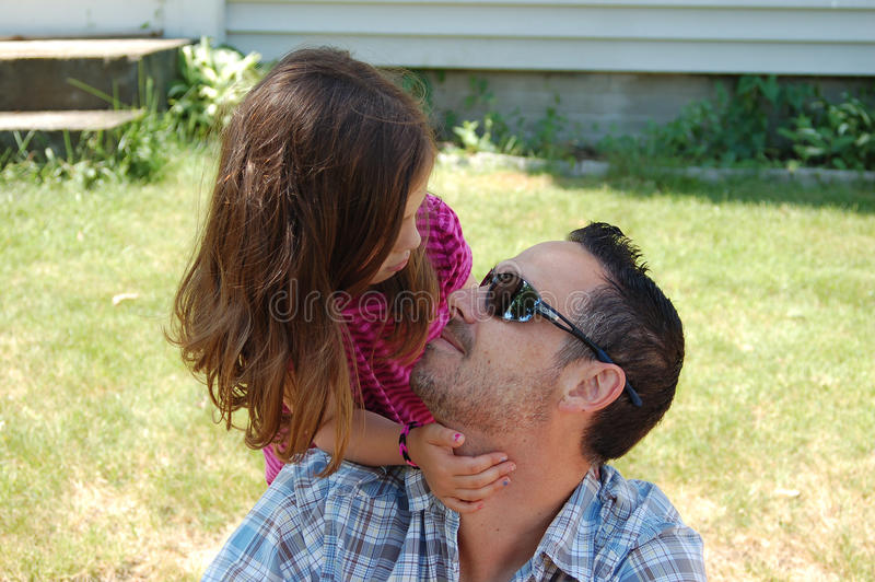 A Father and Daughter's Show of Affection. A father and daughter showing their love and affection for each other royalty free stock images