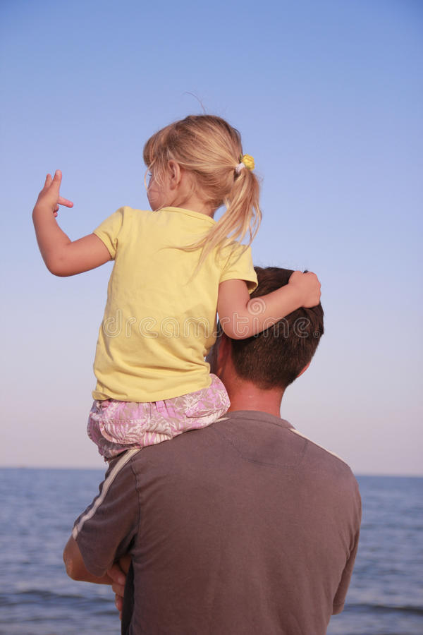 Download Father And Daughter On The Sea Shore Stock Photo - Image: 32202622
