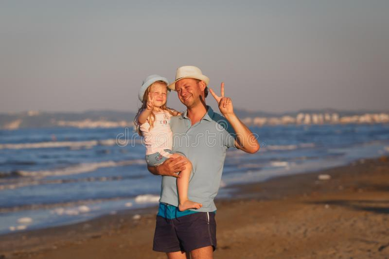 Father with daughter on seashore. Venice, Italy. royalty free stock images