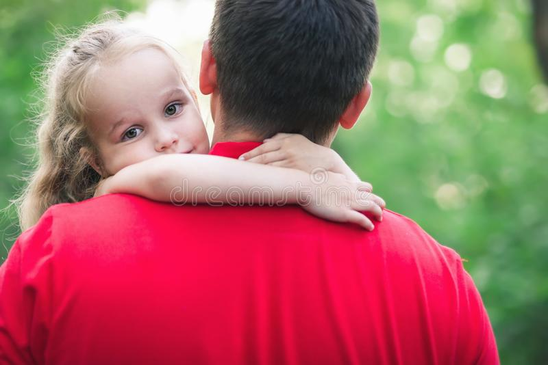 Girl hug her daddy with love. Father and daughter share love. Girl hug her daddy stock image