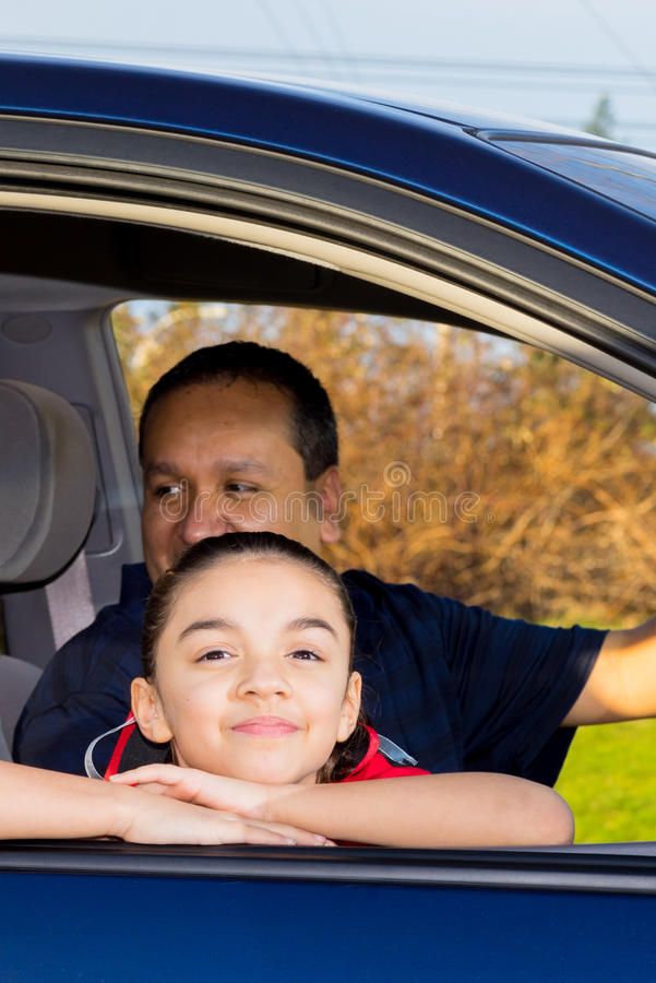 Father And Daughter Sitting In Mini Van royalty free stock image