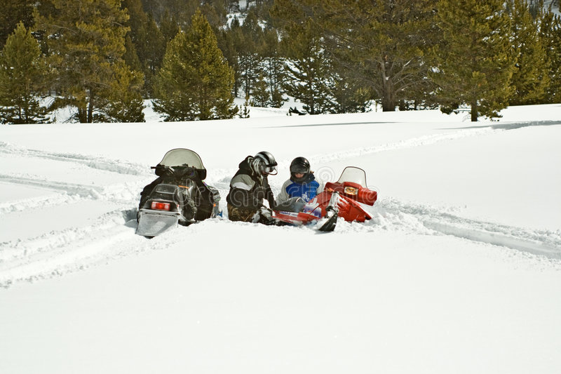 Download Father And Daughter With Stuck Snowmobile Stock Photo - Image: 4721176