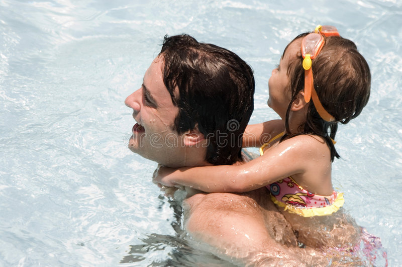 Download Father And Daughter In Swimming Pool Stock Photo - Image of communications, beauty: 6304856