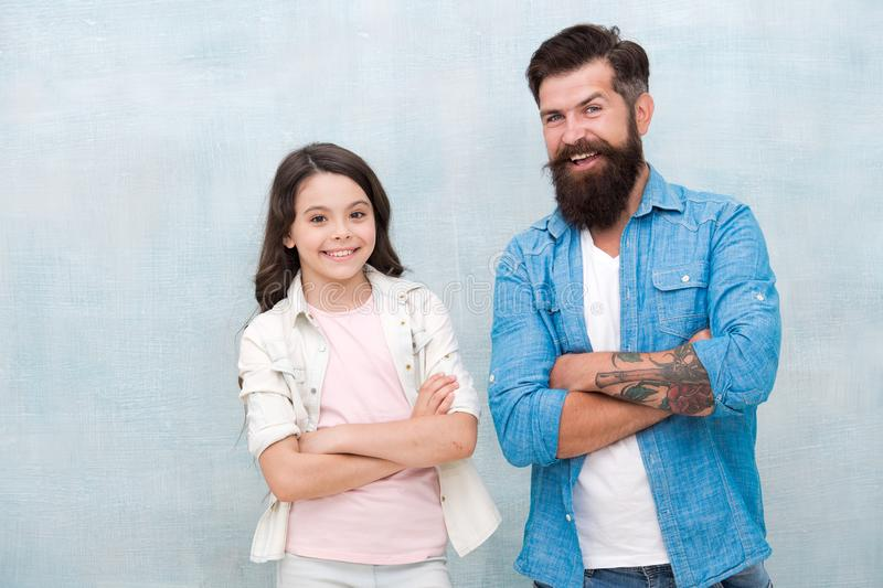 Father and daughter teammates. Team of dad. Bearded hipster man and adorable child girl. We are team. Family team stock photos
