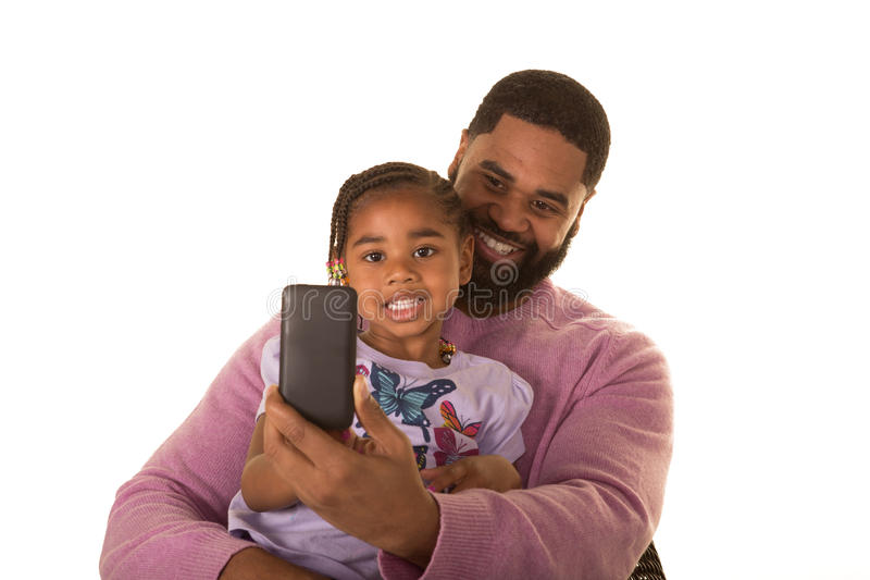 Father, daughter and technology royalty free stock image