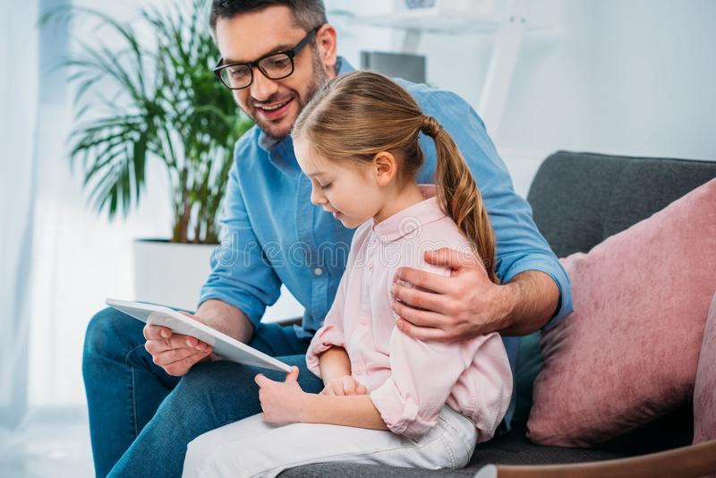 father and daughter using tablet together royalty free stock photos