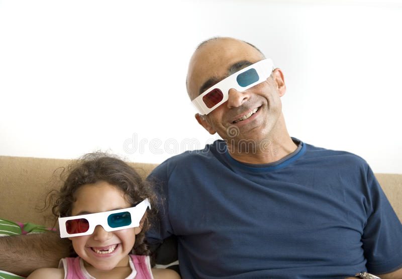 Download Father And Daughter Watching Television In 3D Stock Photo - Image: 14923782