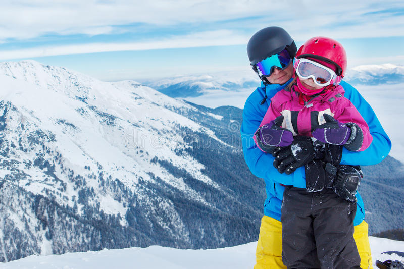 Father and daughter in winter mountains royalty free stock photos