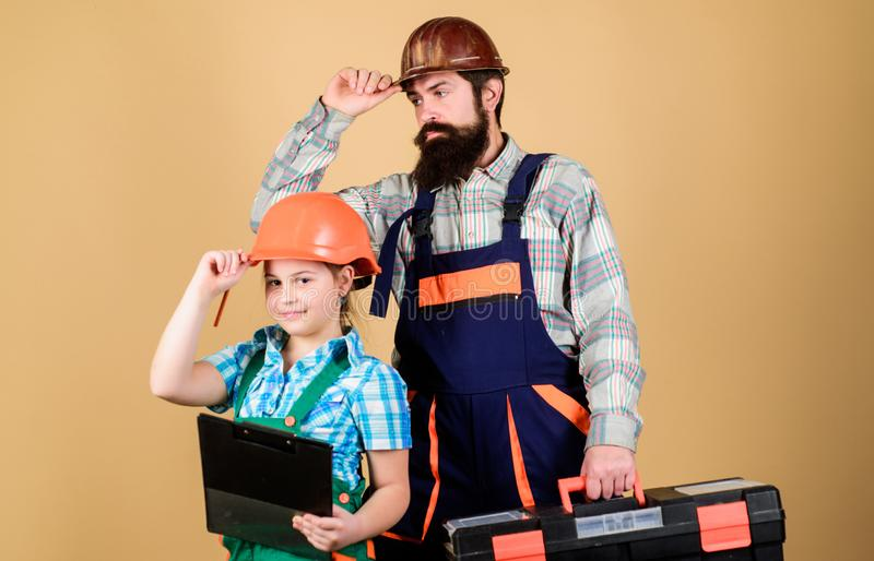 Father and daughter in workshop. Bearded man with little girl. construction worker assistant. Builder or carpenter. Father and daughter in workshop. Bearded men royalty free stock images