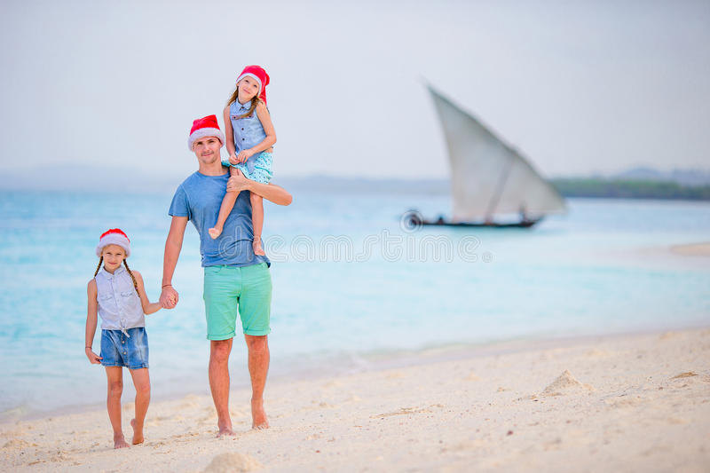 Father and daughters on Christmas vacation. Christmas family holidays on the beach. Father with kids on Christmas vacation. Christmas family holidays on the bea stock photos