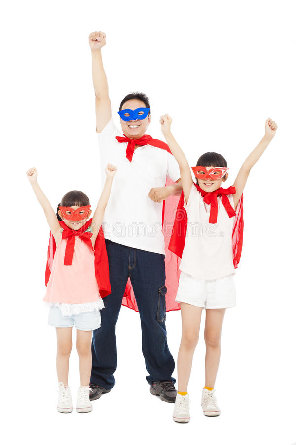 Father and daughters making a superhero pose with red cape stock image