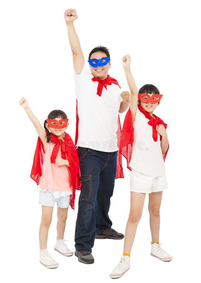 Father and daughters making a superhero pose with red cape stock images