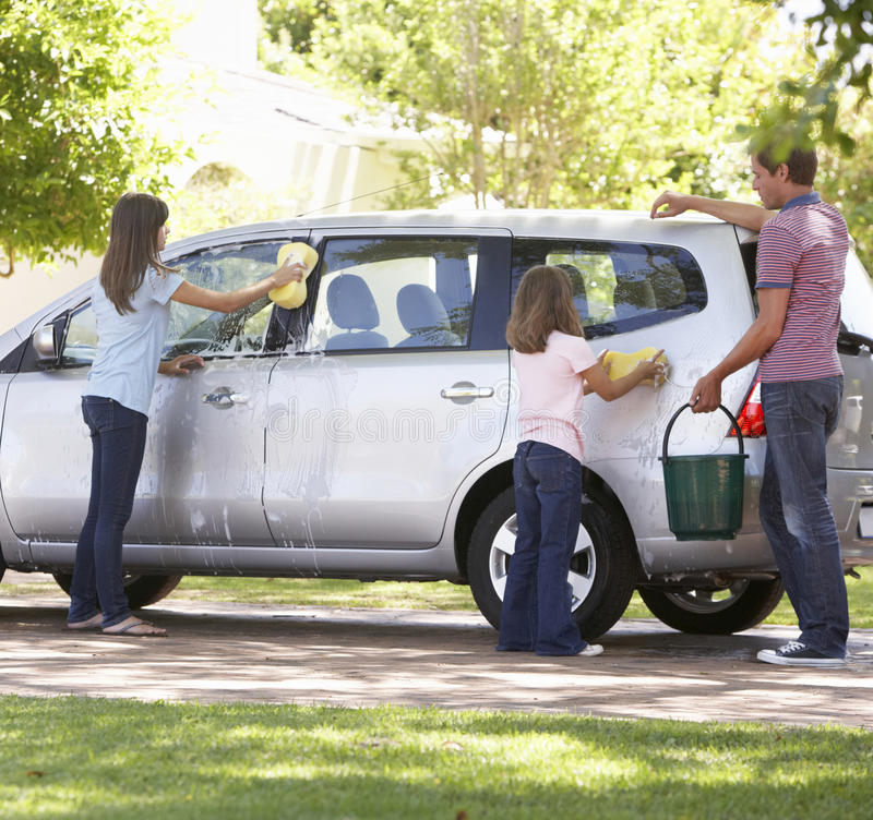 Father And Daughters Washing Car Together stock photo