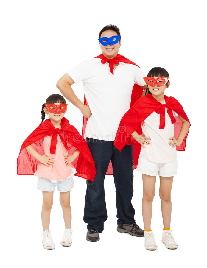 Father and daughters wearing superhero suit. isolated on white royalty free stock images
