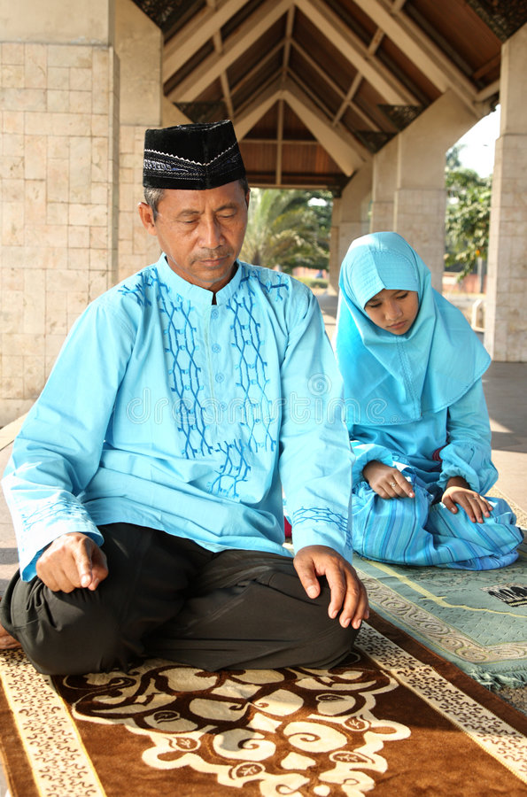 Father and Daughther. Muslim father and young daughter praying