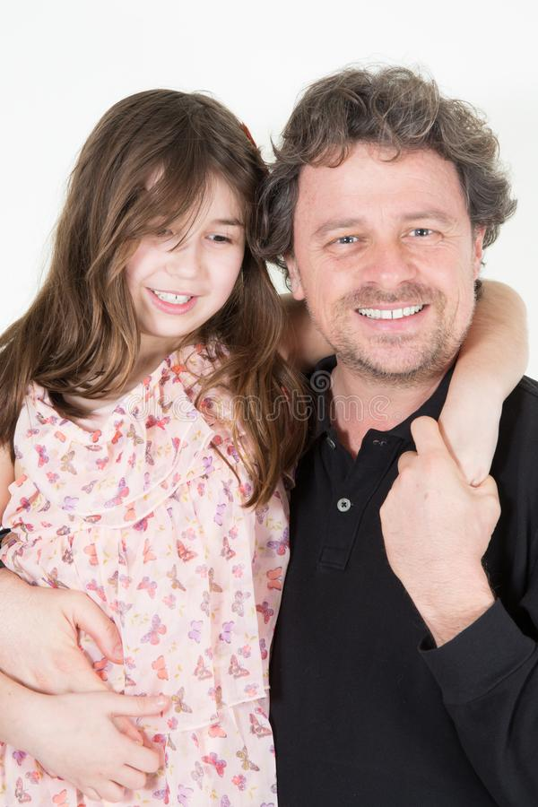 Father day Happy family daughter hugging daddy and laughs on holiday stock images
