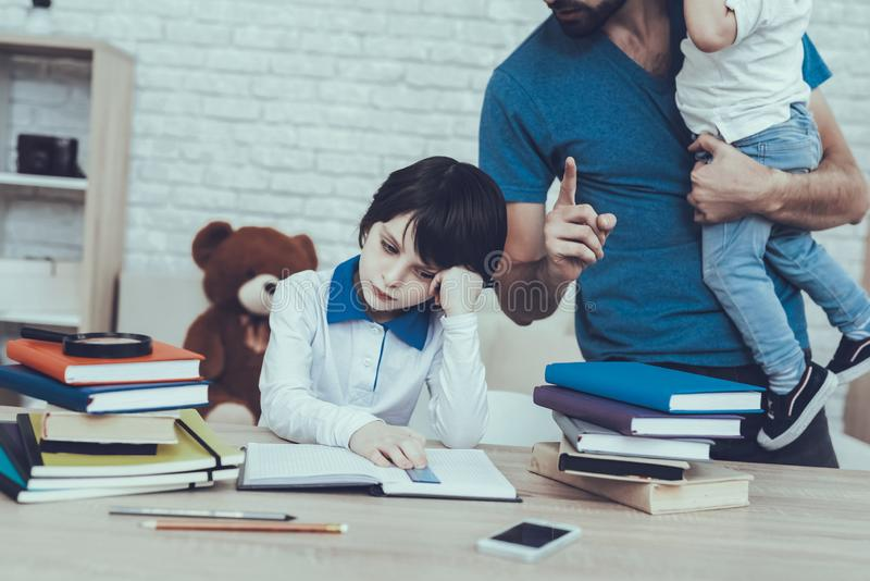 Father is Doing a Homework with Son royalty free stock photography