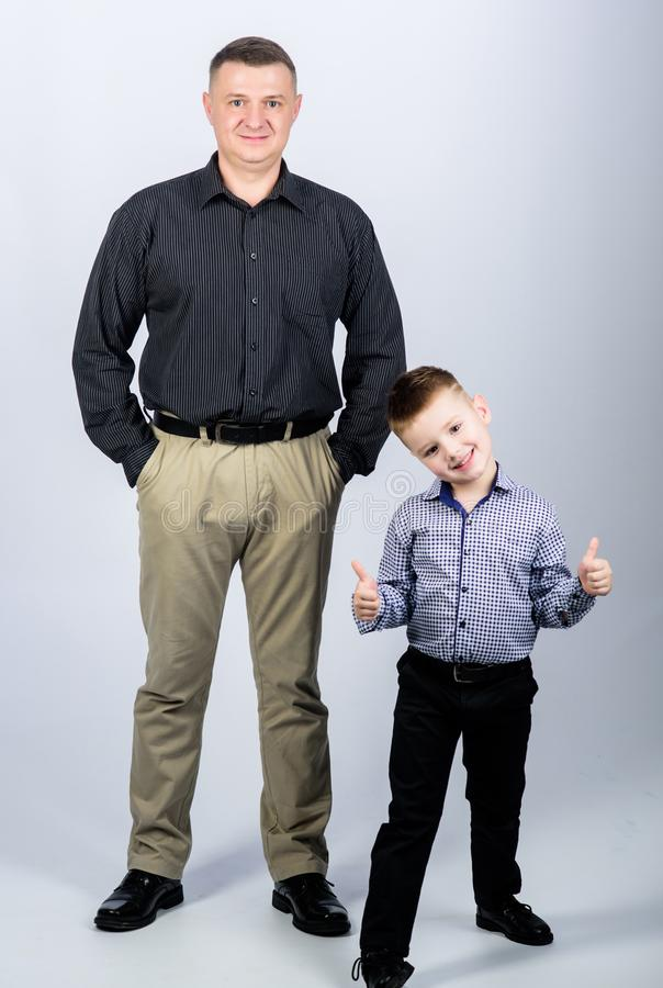 Father example of noble human. Family support. Family bonds. Trustful relations father and son. Enjoying fatherhood. Father and cheerful little son. Best stock photos