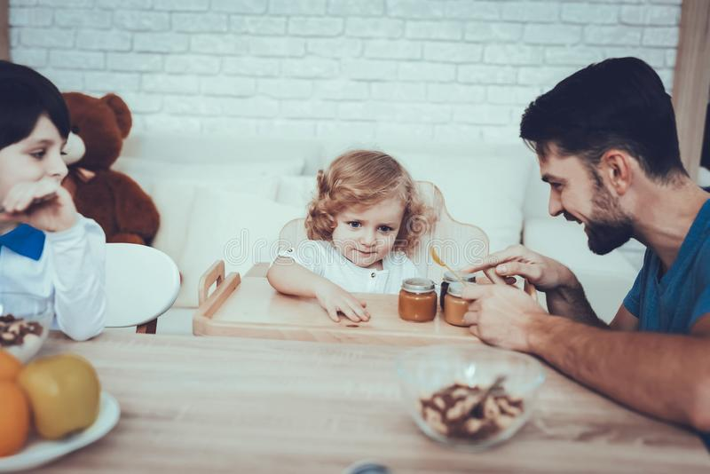 Father is Feeding His Sons a Breakfast stock photography