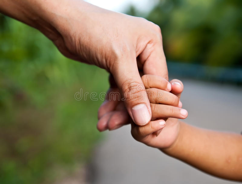 Father finger holding with baby hand. Close up father's finger holding with baby's hand stock image