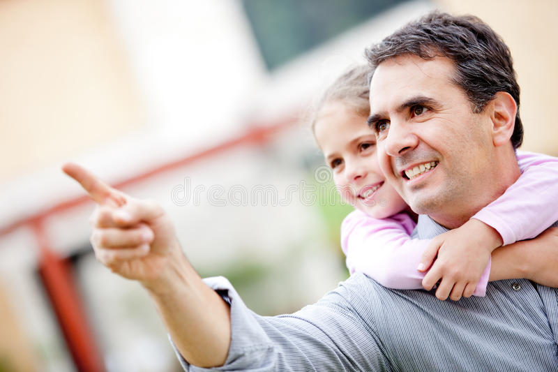 Father and girl pointing