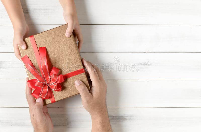 Father gives chrismas gift to his daughter stock photo