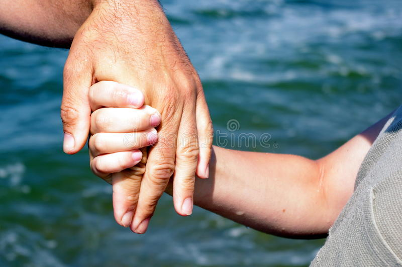 Father giving hand to a child royalty free stock images