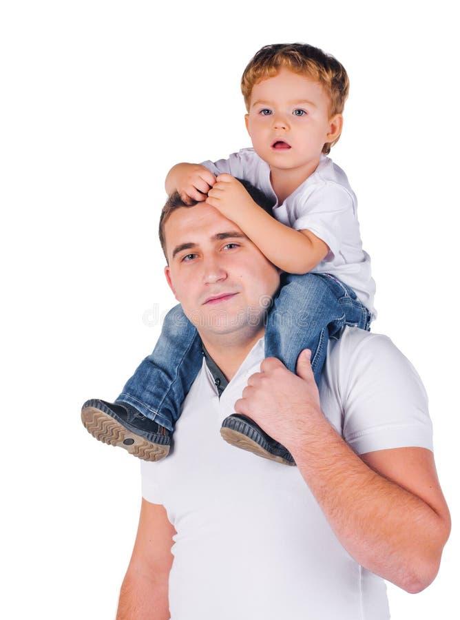 Father giving his son piggyback ride stock photo