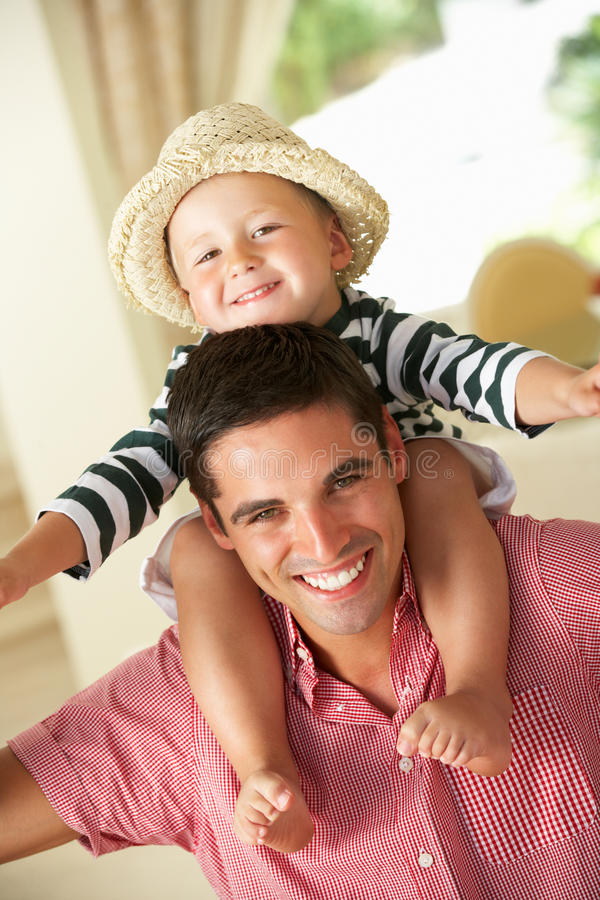 Download Father Giving Son Ride On Shoulders Indoors Stock Image - Image: 27272567