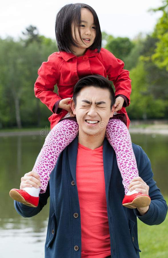 Father is having fun with daughter stock photo