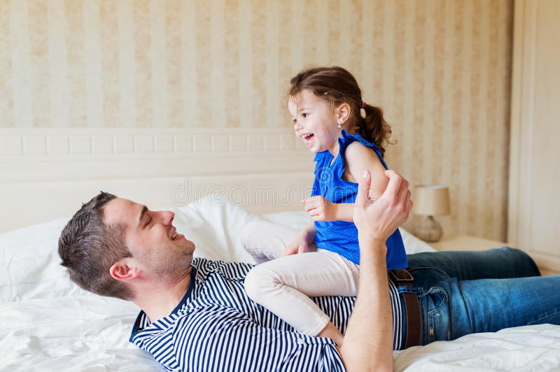 Father having fun with his cute little daughter. Young father having fun with his cute little daughter stock images