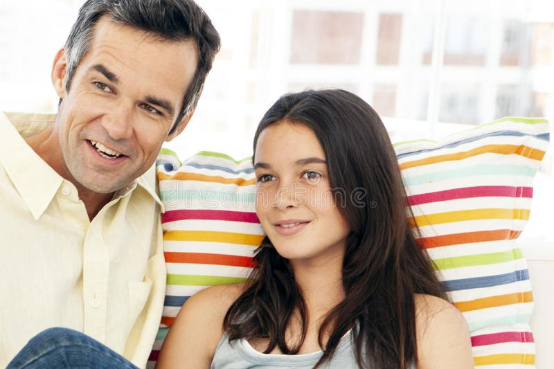 Father having a good moment with teenage daughter at home stock photos